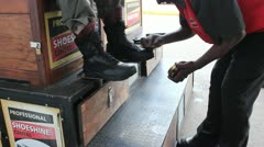 A customer gets his boots shined - stock footage