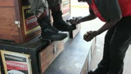 Stock Video Footage of A customer gets his boots shined
