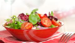 closeup on a fresh salad bowl - stock photo