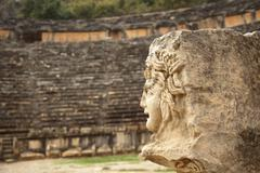 antique stone mask in Myra - stock photo