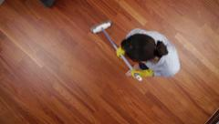 Cleaning lady overhead broom Stock Footage