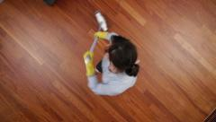 Cleaning lady overhead broom dance Stock Footage