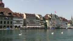 Market street along water in Lucerne Stock Footage