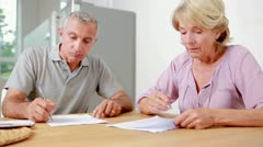 Couple signing documents together Stock Footage