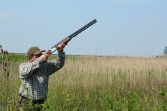 Hunter aiming duck.JPG Stock Photos