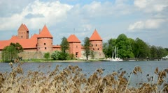 People rest near trakai castle. zorb bubble water bicicle lake Stock Footage
