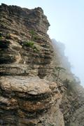 cloudy mountain rock landscape - stock photo