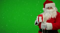 Stock Video Footage of Santa Claus holding a box with christmas gift