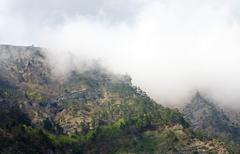 spring cloudy view of slope of aj-petri mount (ukraine) - stock photo