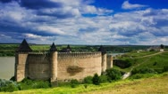 Timelapse of white clouds passing by over an old castle, 4K Stock Footage