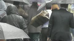 Slow Motion Crowd wet Umbrella London Rain day and macho man with bag - stock footage
