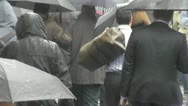 Stock Video Footage of Slow Motion Crowd wet Umbrella London Rain day and macho man with bag