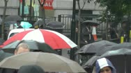 Stock Video Footage of Slow Motion March of Umbrellas in the London rain