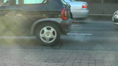 Slow Motion Car Exhaust fumes in the sun Stock Footage
