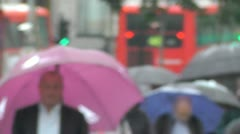 Soft focus  Slow Motion colored Umbrellas move to the sound of the London rain Stock Footage