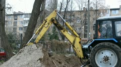 Yellow excavator grab the ground into bucket Stock Footage