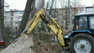 Stock Video Footage of yellow excavator grab the ground into bucket