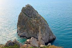 rock on sea background (crimea, ukraine) - stock photo