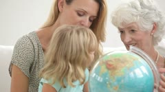 Family looking at a globe - stock footage