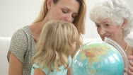 Family looking at a globe Stock Footage