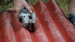 Worker cutting with electric grinder - stock footage