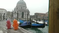 Jelly Babies in Venice Italy background gondola and Santa Maria della Salute Stock Footage