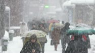 Stock Video Footage of The people crowd in the city, winter, STRONG SNOWFALL, SLOW MOTION