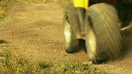 Stock Video Footage of Close up view of ATV wheels in terrain.