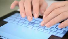 Typing on virtual keyboard. Woman hands and touch screen - stock footage
