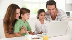 Family using a laptop Stock Footage
