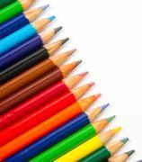 Colored pencils art supplies in a row Stock Photos