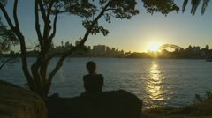 Silhouette lady looking at Sydney cityscape two Stock Footage