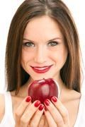 apple held by an attractive manicured woman - stock photo