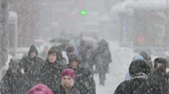 The people crowd in the city, winter, STRONG SNOWFALL, EXTRA ZOOM Stock Footage
