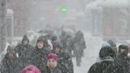 Stock Video Footage of The people crowd in the city, winter, STRONG SNOWFALL, EXTRA ZOOM