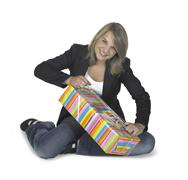 sitting girl unwrapping a present - stock photo