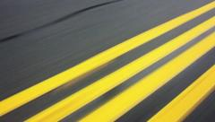 Daytime Rainy Drive With Focus on Double Yellow Traffic Lines Stock Video Stock Footage