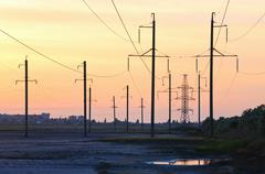 Sunset and high-voltage line Stock Photos