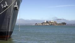 Alcatraz island looking past ship hull california Stock Photos