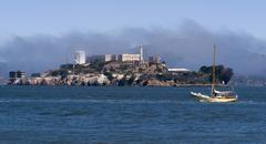 Alcatraz island prison and sailboat bay san francisco Stock Photos