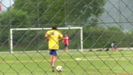 Kids practicing soccer focus on fence Stock Footage