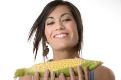Beautiful brunette holds a corn stalk Stock Photos
