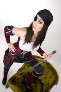 captain's mate pirate woman with sword - stock photo