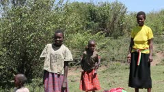 Maasai Woman and Children on Laundry Day Stock Footage
