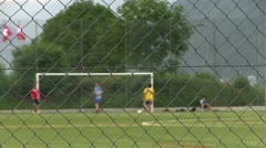 Kids practicing soccer focus on fence part 2 Stock Footage
