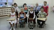 A group of small children playing musical instruments Stock Footage