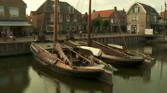 Dutch small village harbor old wooden ships Stock Footage