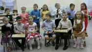 Stock Video Footage of a group of small children playing musical instruments