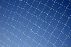 close up of a soccer net. - stock photo