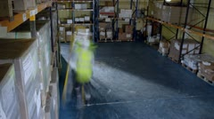 Time lapse of workers in a warehouse or factory Stock Footage